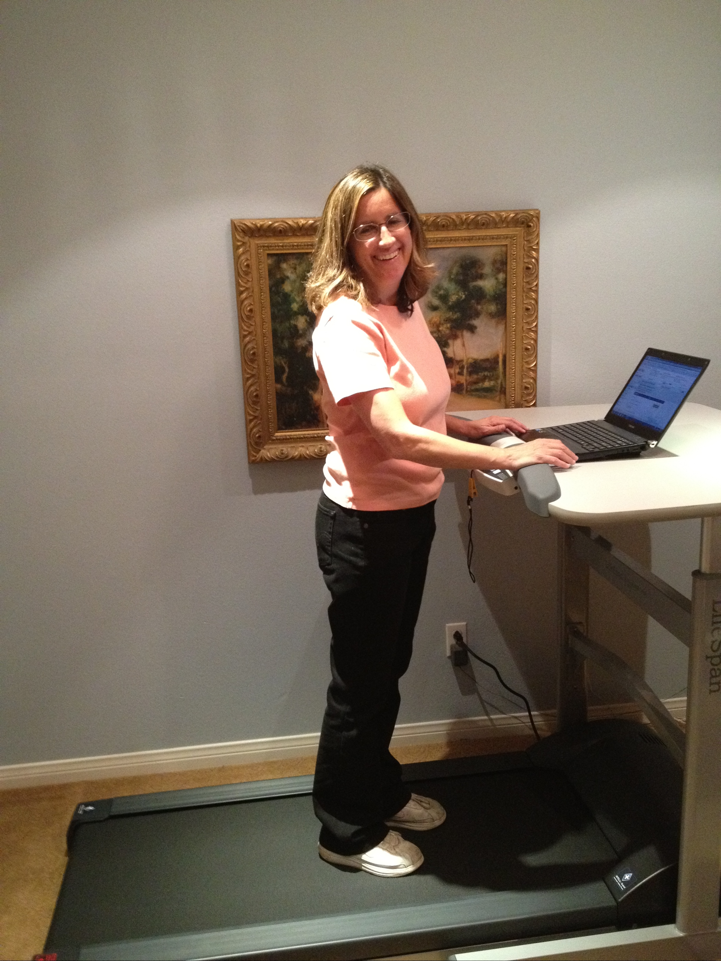 I've been using my new toy-- a treadmill desk-- every day since I got it a few weeks ago. I love it! I go only 1-1.5 miles an hour on it, but at that speed I barely know I'm exercising (well, I barely am exercising) and can surf the Net almost guilt-free. I was inspired by author Art Slade, who made his own treadmill desk a few years ago, and a study that sitting all day is really bad for your health. The best thing about the treadmill desk is that I can fit a large pizza on it. Kidding.