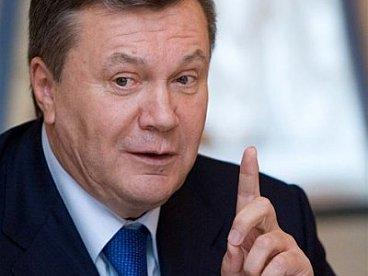 Янукович с указательным пальцем