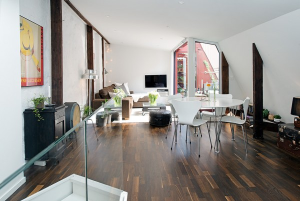 a-Urban-Apartment-with-Terrrace-white-living-broken-by-exposed-beams-and-matching-hardwood-floors-600x402