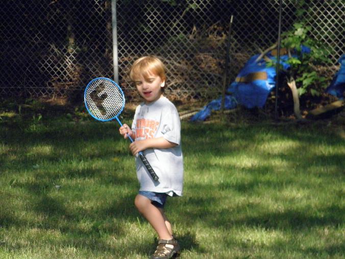 Daniel, age 4, playing badminton