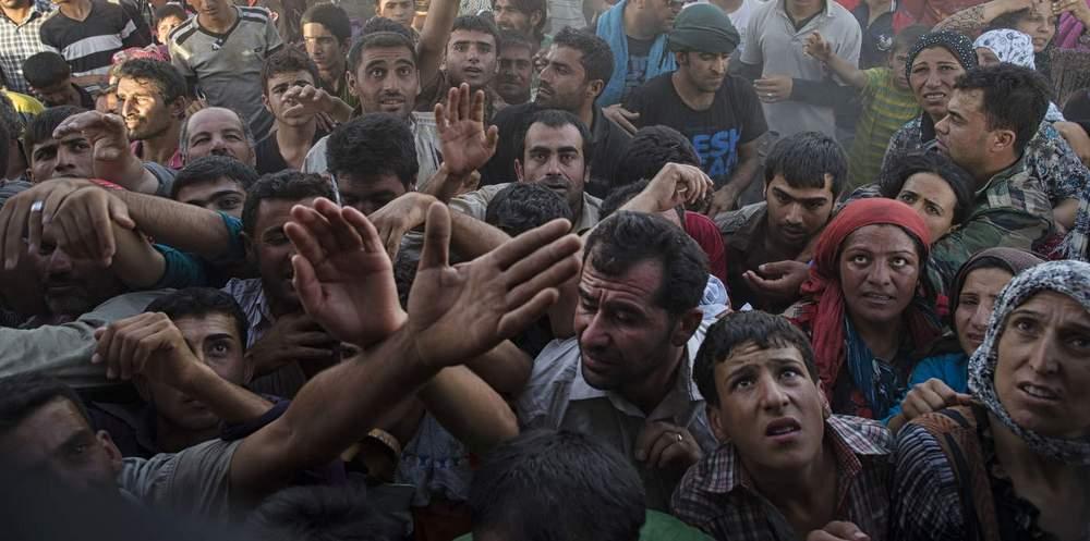 Сирийские беженцы на севере Ирака отнимают продукты у курдских беженцев. Фото Линдси Аддарио для New York Times