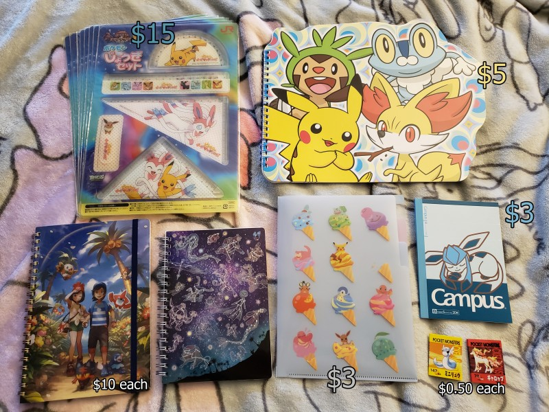 XY starters sketchbook has the front cover outline on each page; pokemikke folder has multiple divided sections; rapidash journal is slightly bent