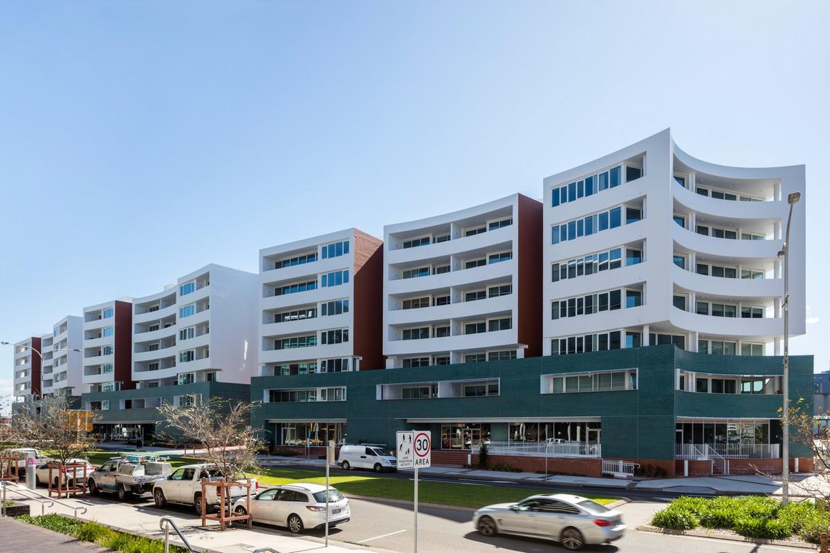 Современный жилой комплекс на набережной в развивающемся районе Ньюкасла