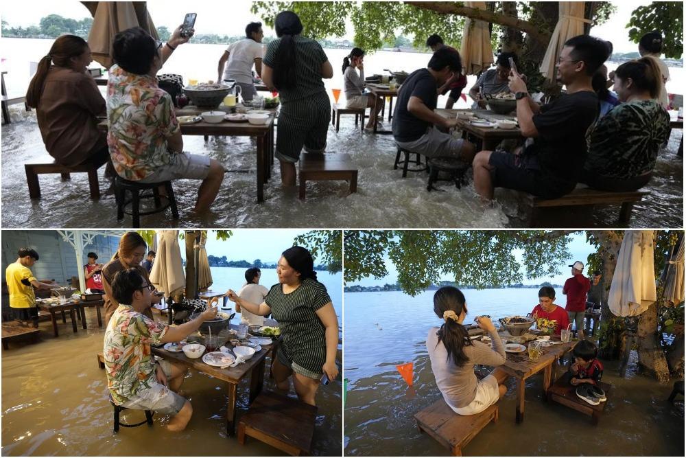 Ресторан в Таиланде затопила река: гости обедают по колено в воде и им нравится