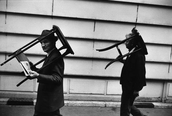 Richard Kalvar  Paris. Men walking with tables on heads