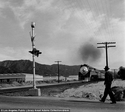 Ansel Adams  A dapper gentleman approaches train tracks in Burbank
