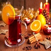 festive-display-of-mulled-wine-garnished-with-oranges-and-cinnamon-sticks-star-anise-candles-and-other-christmas-decorations.jpg