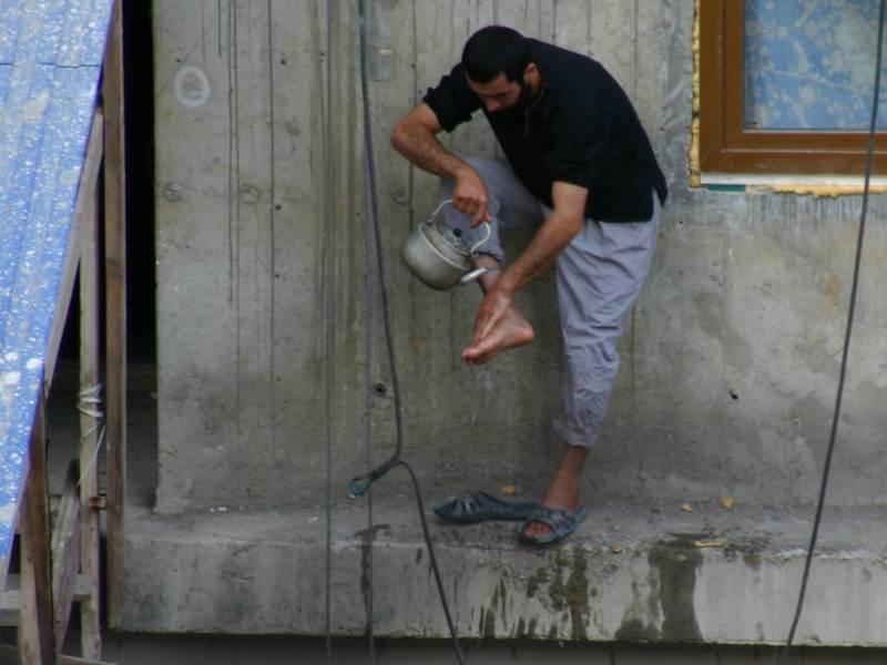 таджики на стройке в россии