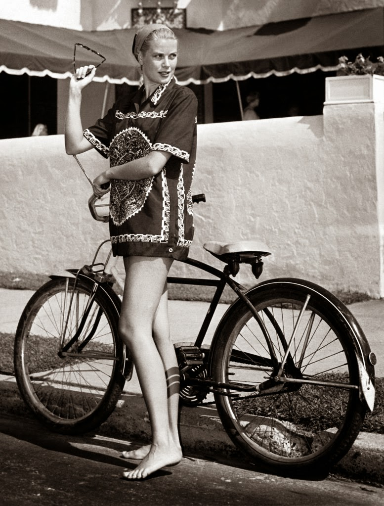 Grace Kelly and her bicycle in St. Tropez, 1954