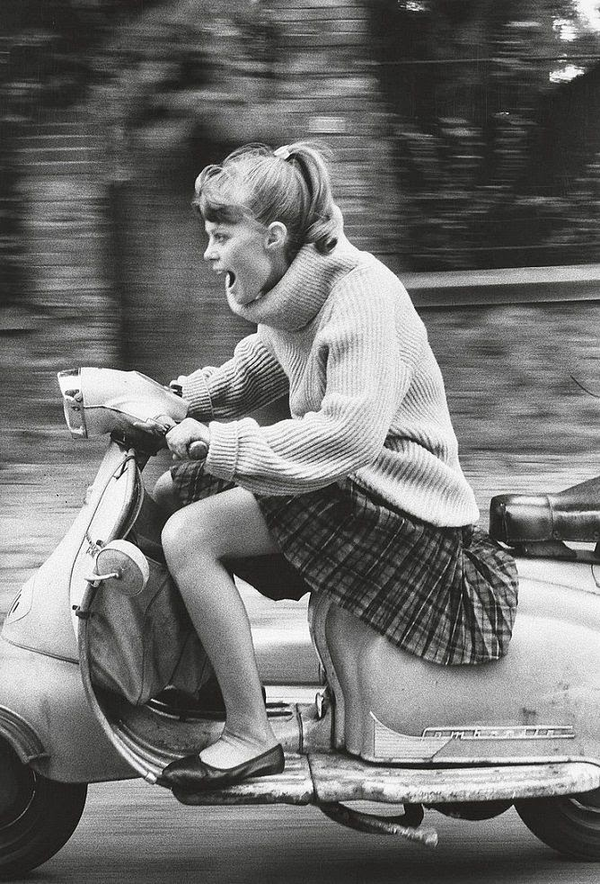 Woman_riding_scooter_photo_by_Jean_Fran_ois_Jonvelle_1984