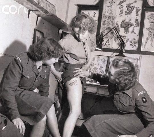 Women Admiring Tattoo