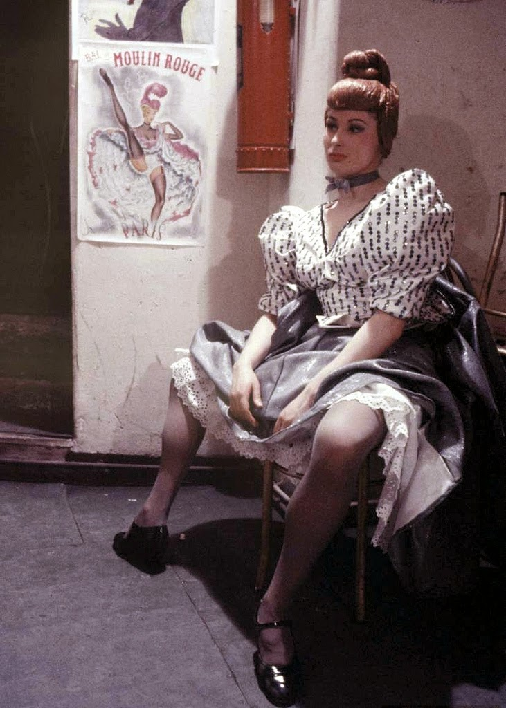 Can-can dancer taking a break at the Moulin Rouge, photo by Loomis Dean, Paris, 1953