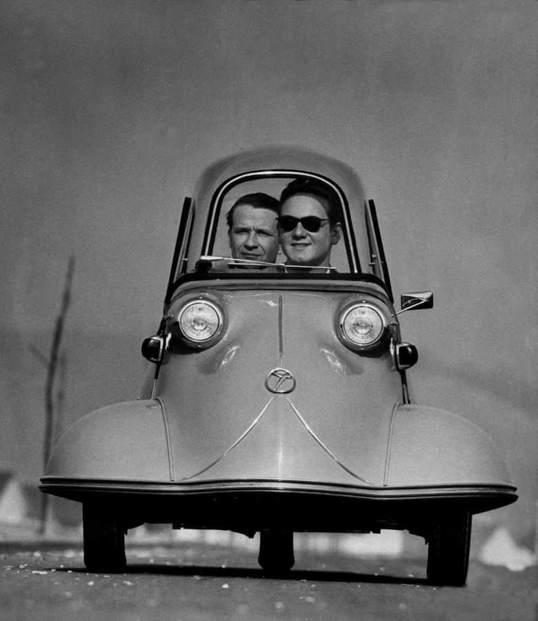 Front shot of two men riding in the three wheeled German made Messerschmidt. 1954