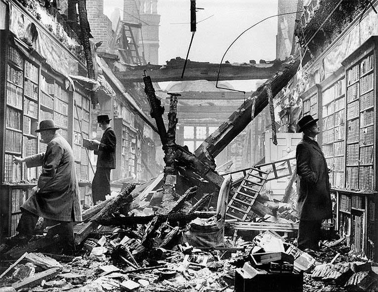 London readers continue to browse at a bombed-out Library caused by WWII - Holland House, Kensington, London, 1940