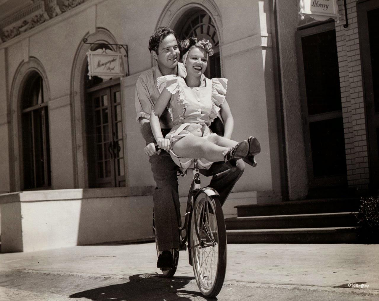 Broderick Crawford and Jane Frazee ride a bike, 1942