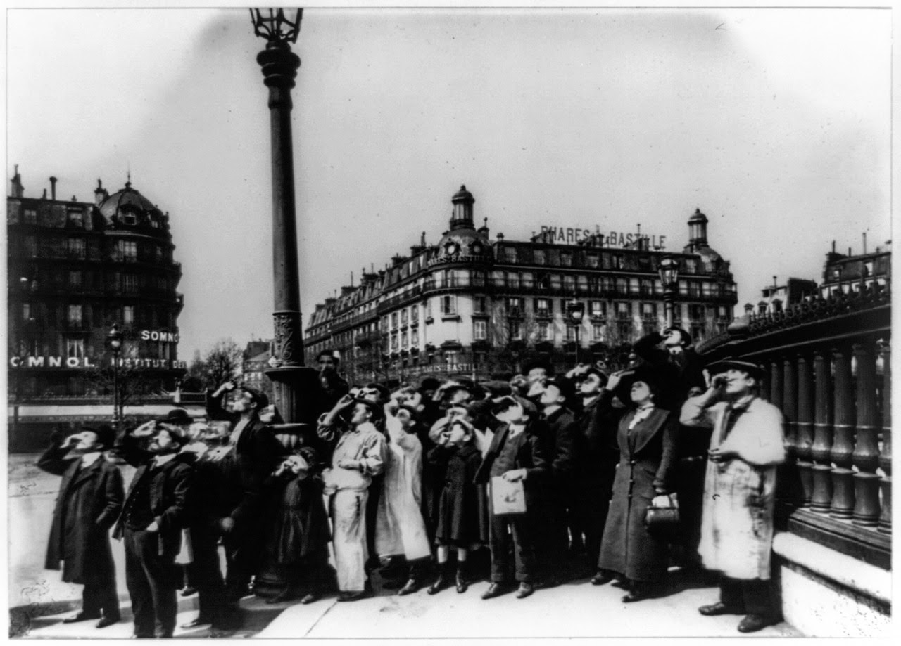 Watching a solar eclipse, Paris, 1911