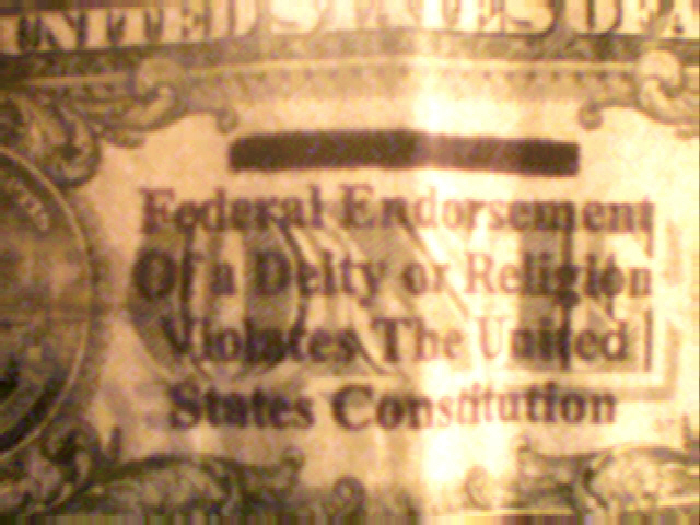 One_dollar_bill_with_In_God_We_Trust_marked_out