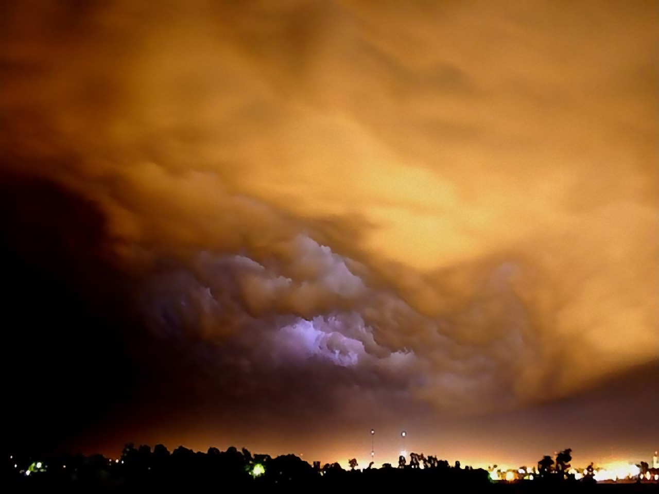 billowing-storm-clouds-over-houses