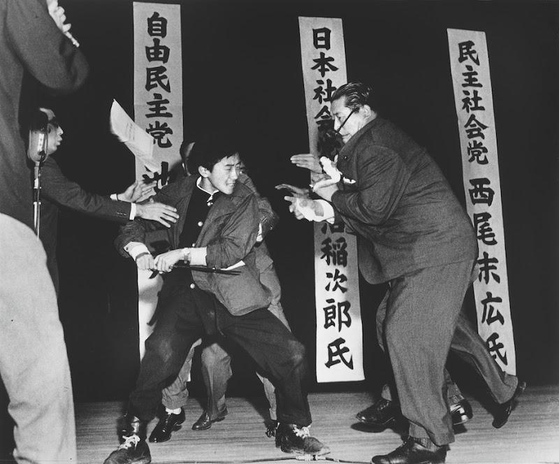 A right-wing student in Japan assassinates Inejiro Asanuma, Socialist Party Chairman, during his speech at the Hibiya Hall. (Yasushi Nagao)