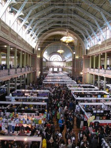 a photo of the Royal Exhibition Building in Melbourne from the second floor balcony, overlooking the Comic Con 2013 merch floor