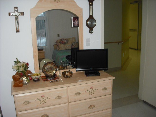 The dresser with some of her knick-knacks. Even bought her a new TV (got cable, too!): let's just say that the massive 38-inch set she had before wouldn't quite fit on that dresser.