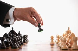 bigstock_Businessman_Playing_Chess_Game[1]