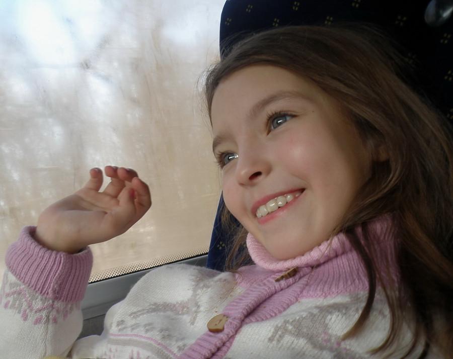 Девочка с лучистой улыбкой