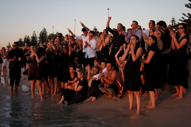 Family and friends swim in the ocean outside of the Indiana Tea House at Heath Ledger's wake on February 9, 2008 in Perth, Australia.