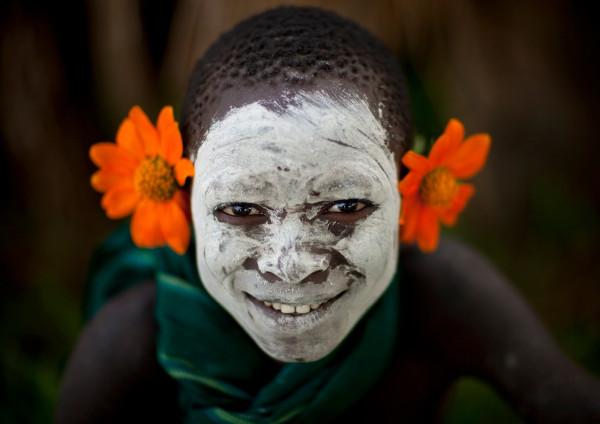 Surma_boy_with_flowers_-_Ethiopia