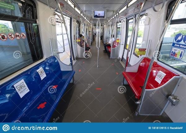 people-wearing-face-mask-as-ride-lrt-train-kuala-lumpur-malaysia-may-seats-marked-off-social-distancing-181813915