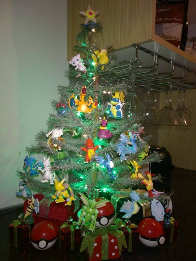 this was my first pokemon christmas tree back in 2014 pretty happy with how it turned out though i had to put ornament hooks around the necks of most of my