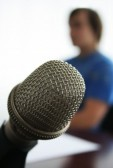 711791-microphone-in-the-foreground-in-radio-studio