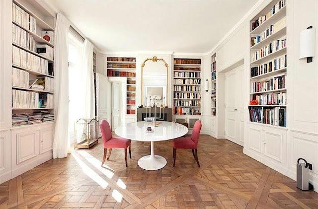 sothebys paris apartment neuilly sur seine dining room books built in bookshelves shelves parquet floors saarinen white tulip table cococozy