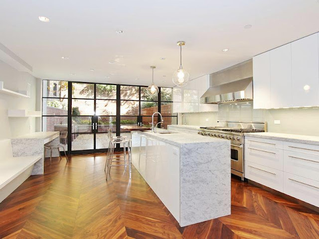 nyc upper east side apartment house kitchen marble island herringbone wood floors cococozy