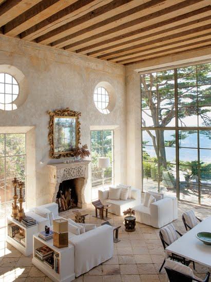 living room floor to ceiling steel encasement windows exposed beams ocean view  cococozy