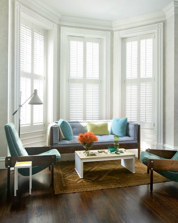 frank roop alcove bay windows plantation shutters wood settee sofa matching armchairs lounge chairs woven rug