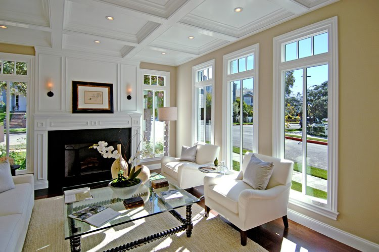 meridith baer living room khaki wall white trim  tall windows street view