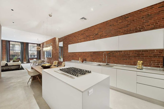 new york loft white modern sleek open kitchen cococozy exposed brick concealed appliances