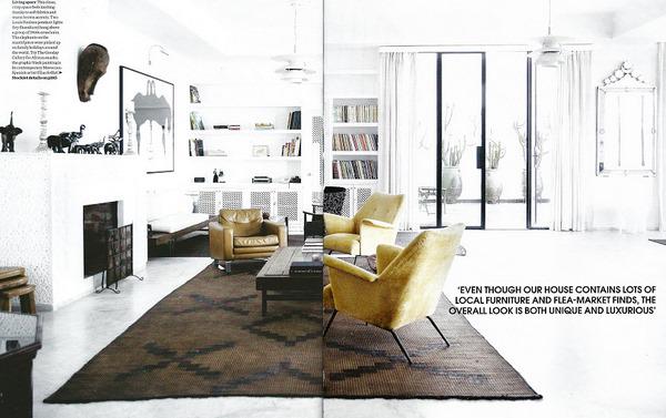 white moroccan living room brown rug ornate mirror elle dec