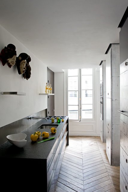 Modern kitchen with african masks via cote paris