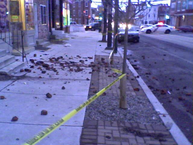 Broken bricks on the sidewalk