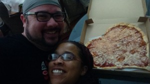 [IMAGE: the cute couple and their cute pizza]