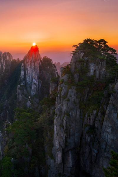The Rising Sun, Huang Shan Mountain, China by Joshua Zhang