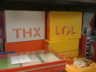Image of notecards with cutouts that say L O L and T H X