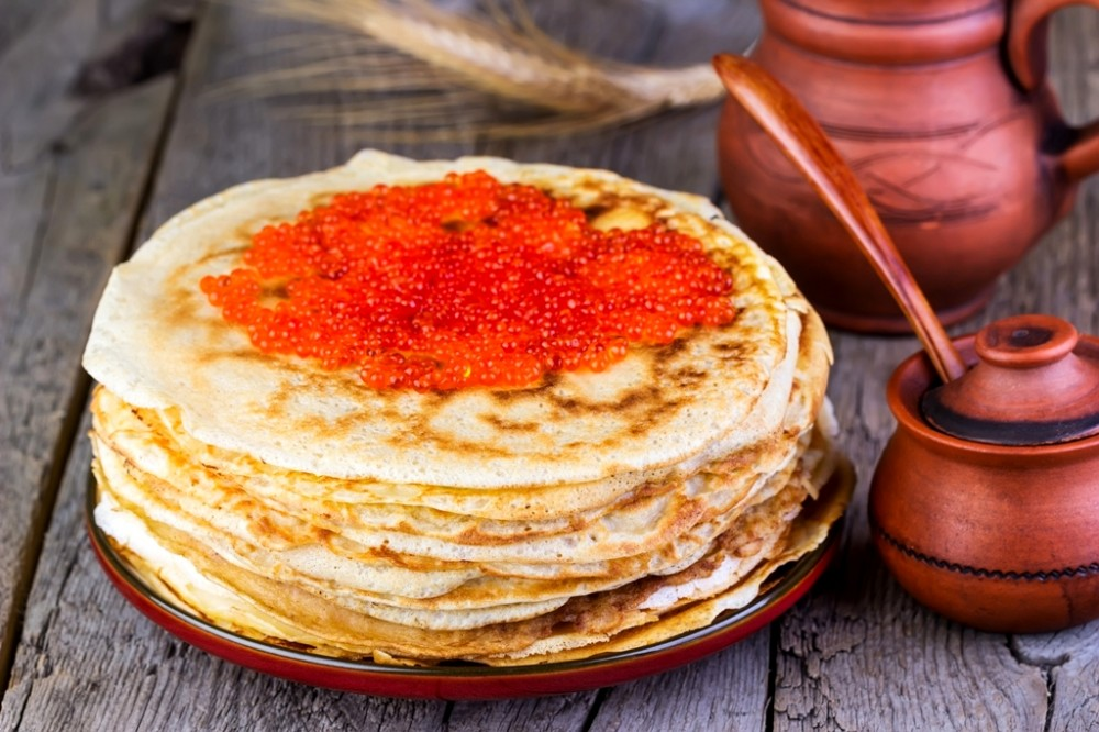 2018Holidays___Carnival_A_pile_of_pancakes_with_red_caviar_on_a_wooden_table__a_treat_for_Shrovetide_121717_