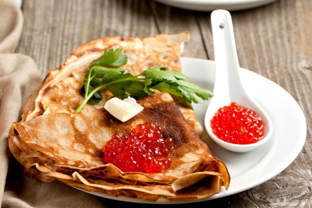 2018Holidays___Carnival_Ruddy_thin_pancakes_with_red_caviar_on_Pancake_week_121716_
