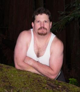 Muscle shirt on log