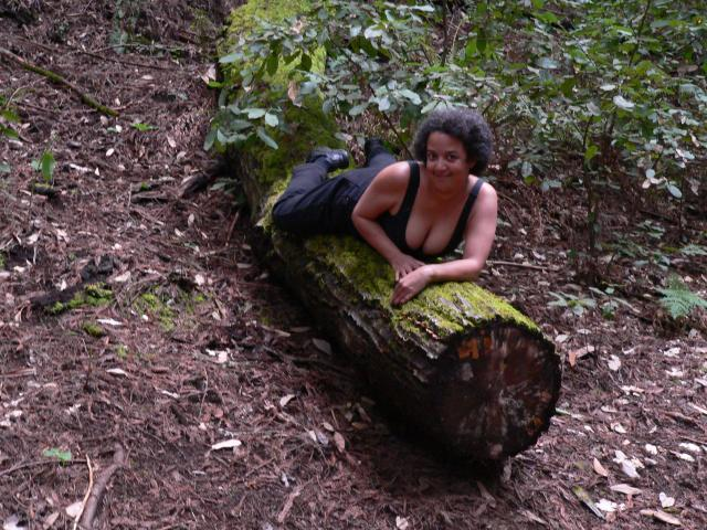 Black tank top on log