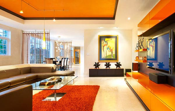 modern-orange-living-room-with-brown-sofas-and-orange-carpet