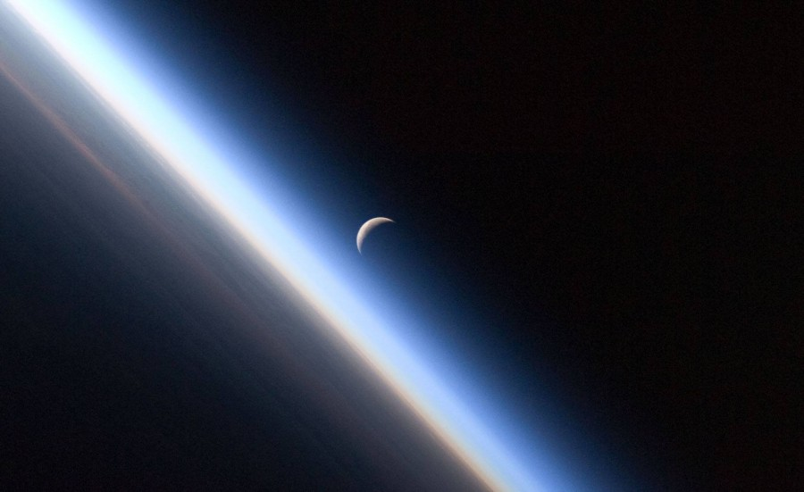 The crescent Moon plays with the Earth's Atmosphere...